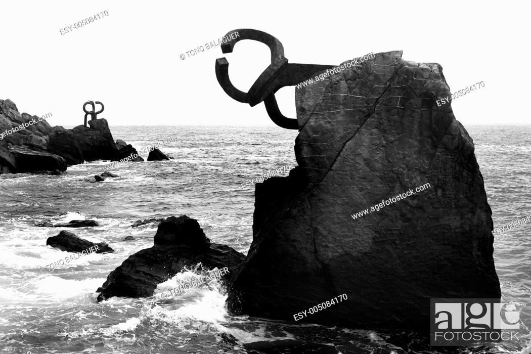 Stock Photo: Chillida rusty steel sculpture in San Sebastian.