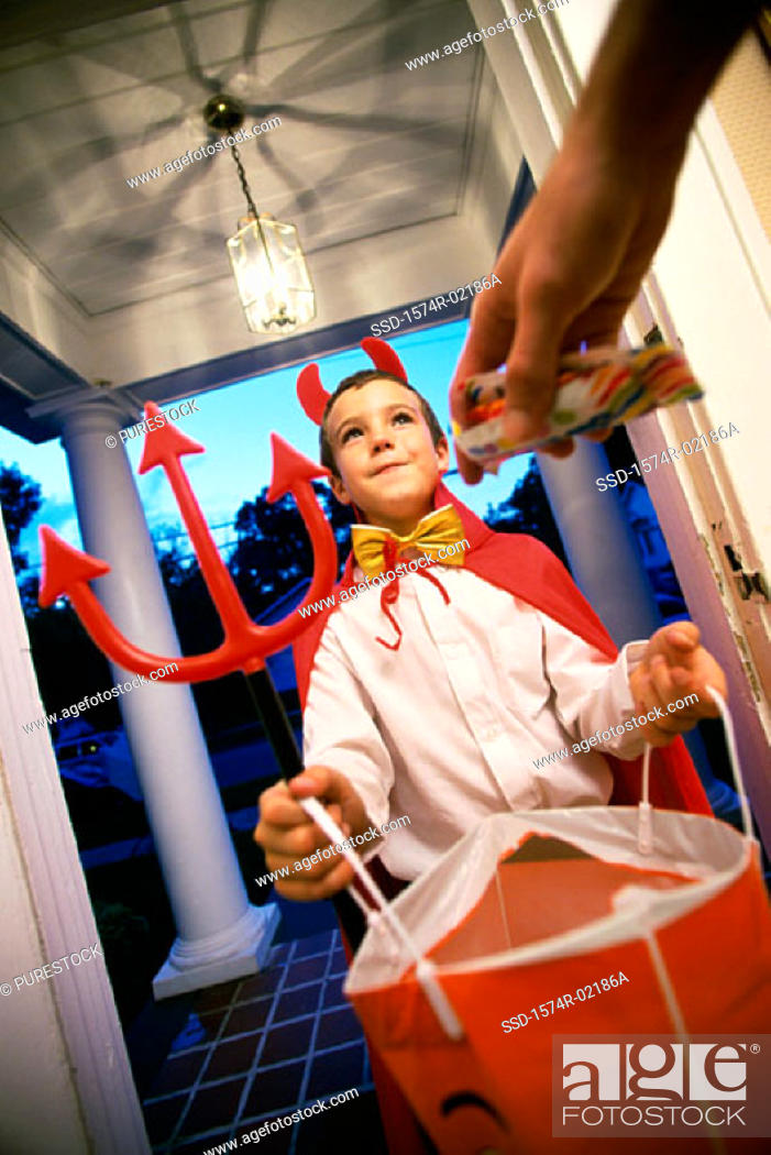 Stock Photo: Low angle view of a boy dressed as the devil on Halloween.