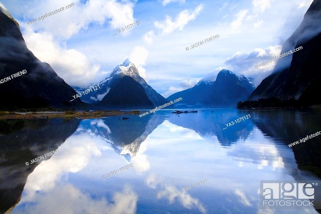Stock Photo: New Zealand, Southland, Fiordland National Park  A clearing storm above Mitre peak, reflected in the still waters of the Milford Sound.