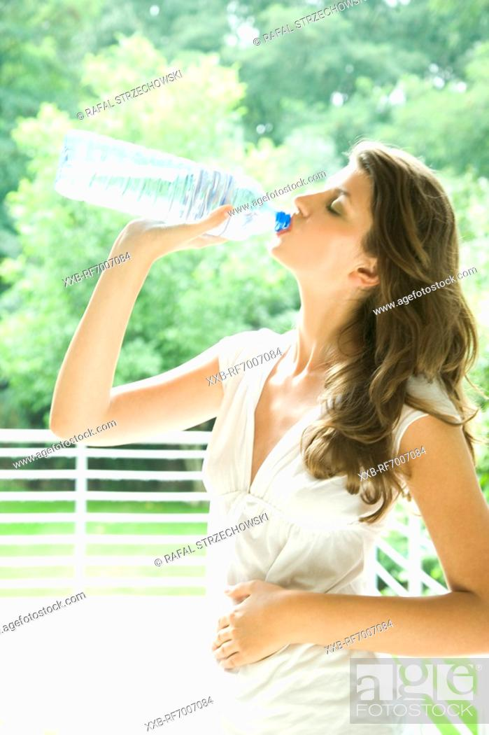 Stock Photo: Woman with bottle of water.