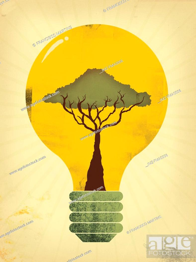 Stock Photo: A tree growing in a glowing lightbulb.