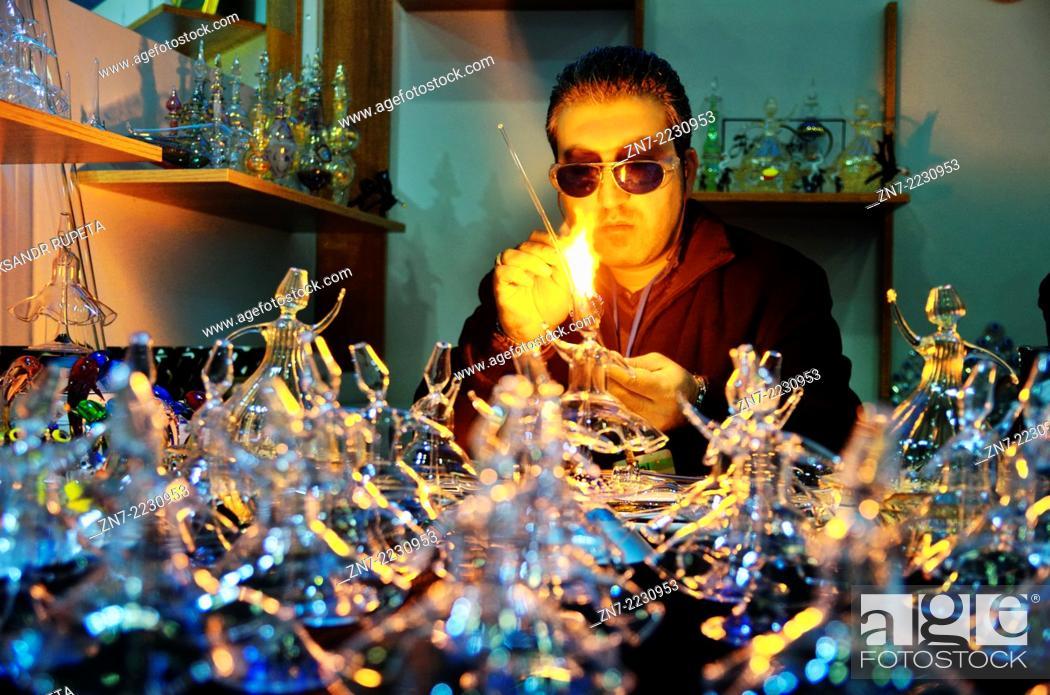 Stock Photo: Glassblower makes glass figures of whirling dervishes in Mevlana Cultural Center, Konya, Turkey.