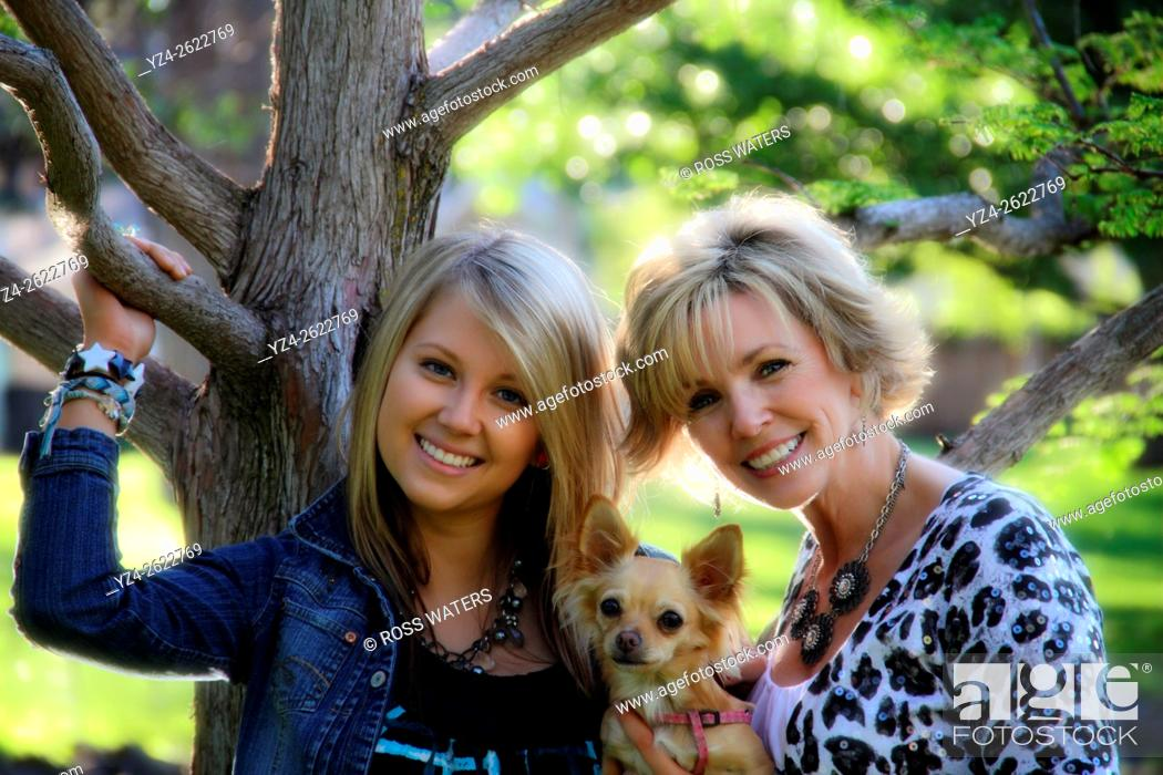 Stock Photo: A woman and her daughter outdoors at a park with their dog in Spokane, Washington, USA.