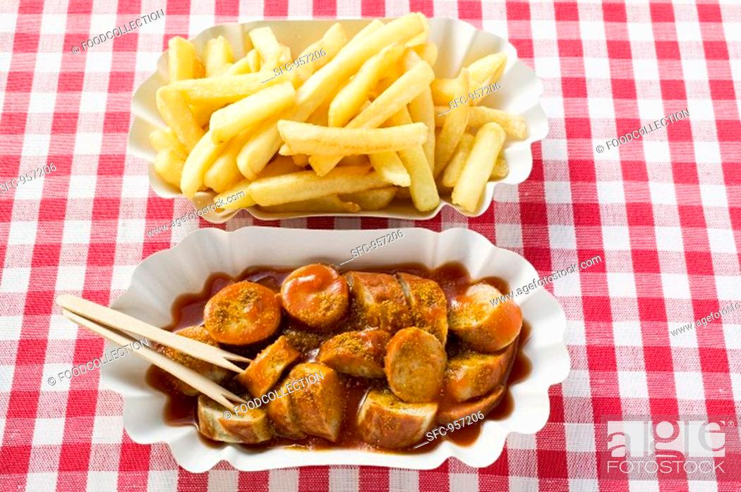 Stock Photo: Currywurst sausage with ketchup & curry powder with chips.