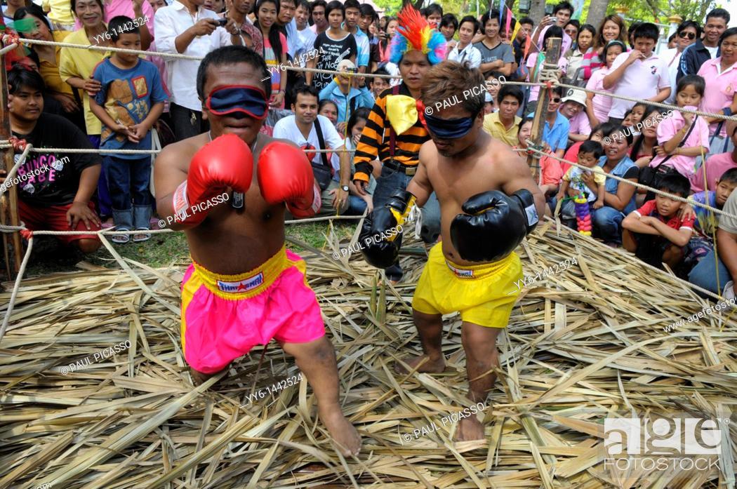 Stock Photo: Dwarf kick bokers fighting blind fold, crazy sport during kings birthday celebrations, suan luang rama 9 park, Bangkok, thailand.