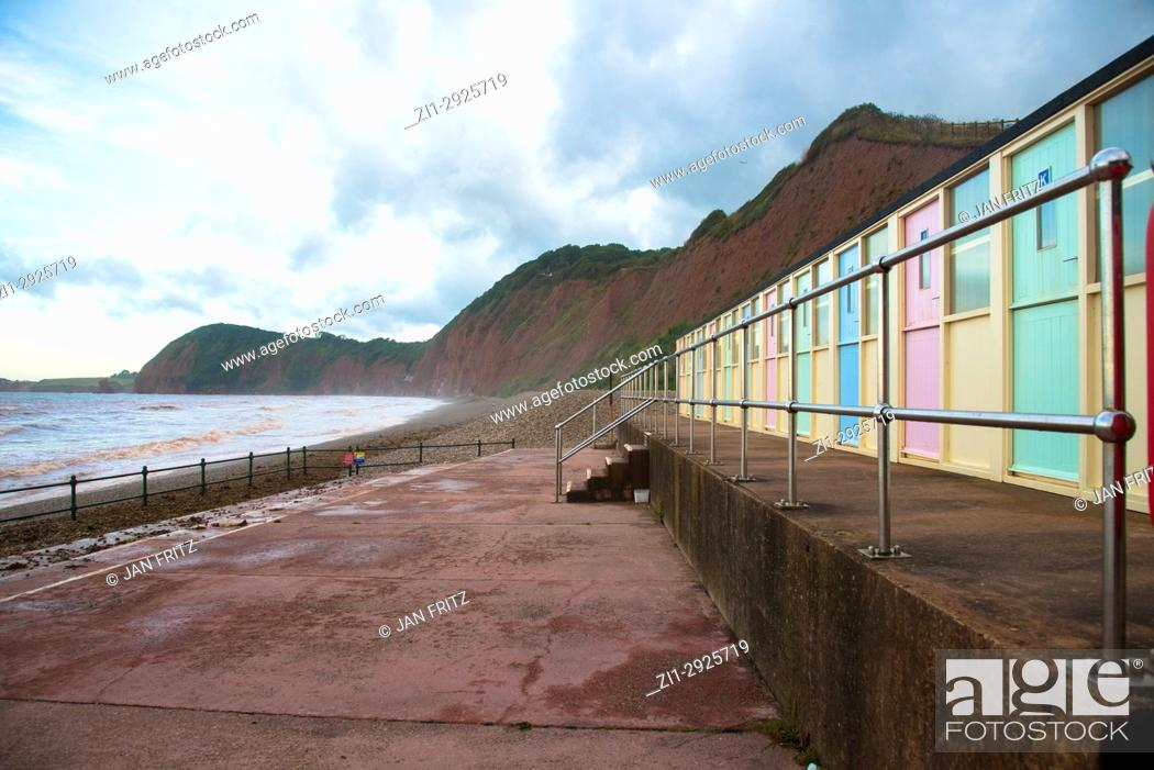 Stock Photo: beache, brown sandstone cliffs and wooden beachcabins at Sidmouth, England.