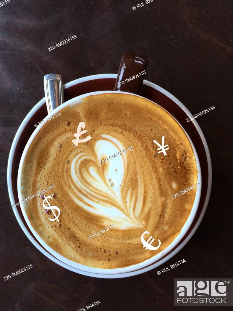 Imagen: Major world currencies in a latte, conceptual image.