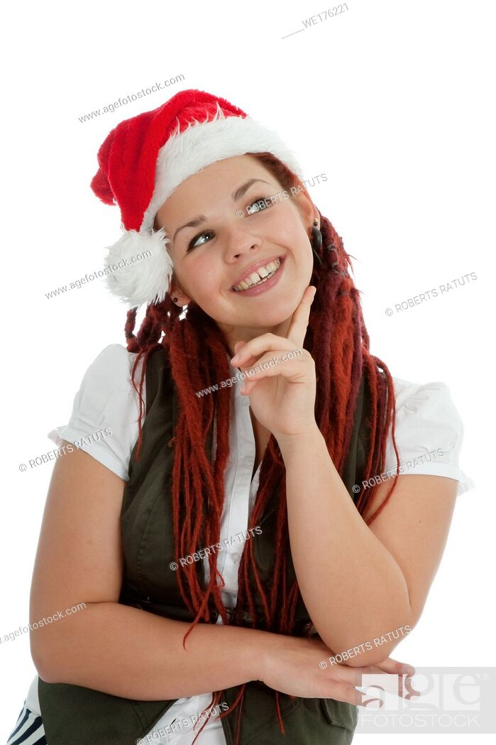 Imagen: Young modern girl wearing Santa Claus hat isolated on white background.