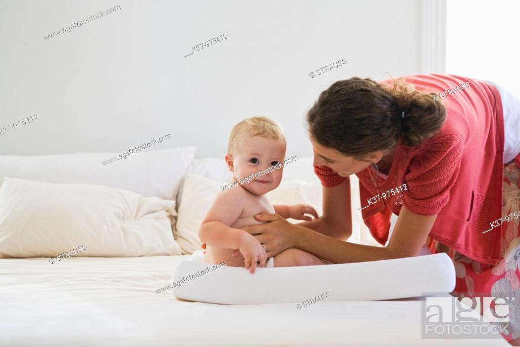 Stock Photo: Mom with baby wearing cloth diaper  MR0904 MR0906 PR0911.