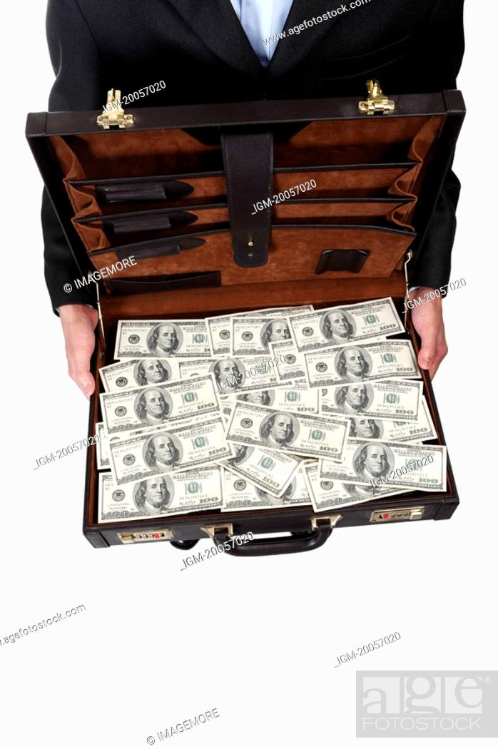 Stock Photo: Human hands holding a suitcase with US paper currency.