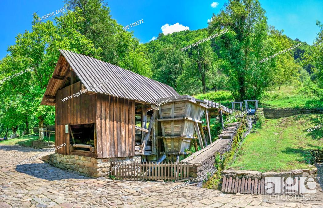 Stock Photo: Saw mill in the Etar Architectural Ethnographic Complex in Bulgaria on a sunny summer day. Big size panoramic photo.