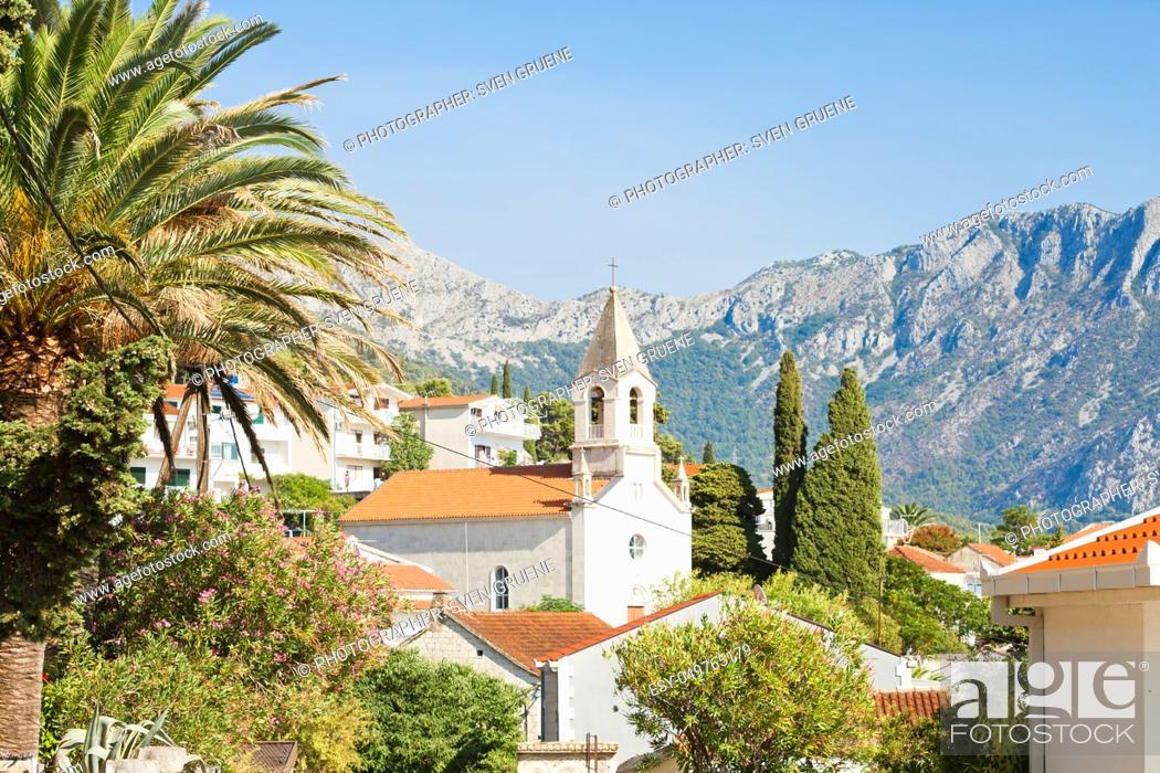 Stock Photo: Brist, Dalmatia, Croatia, Europe - Church of Brist in front of the mountains.