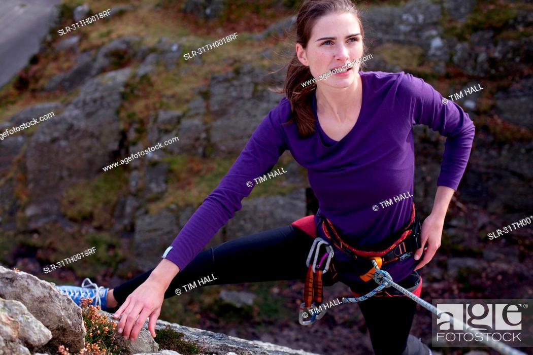 Stock Photo: woman rock-climbing.