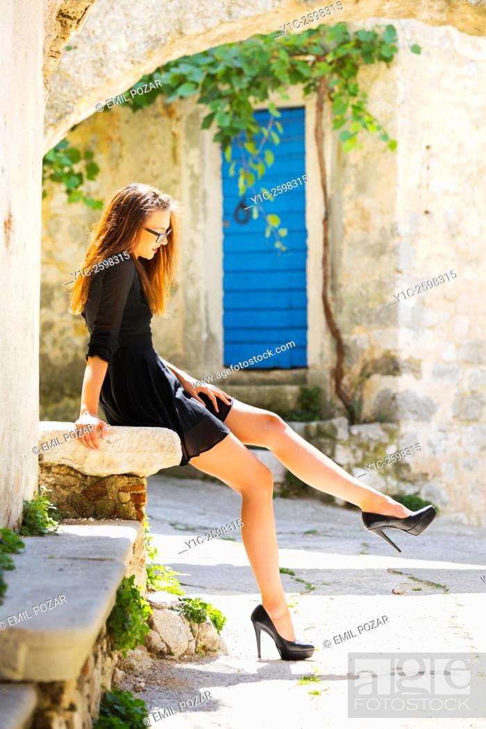 Stock Photo: Long-legged young woman sunbathe.
