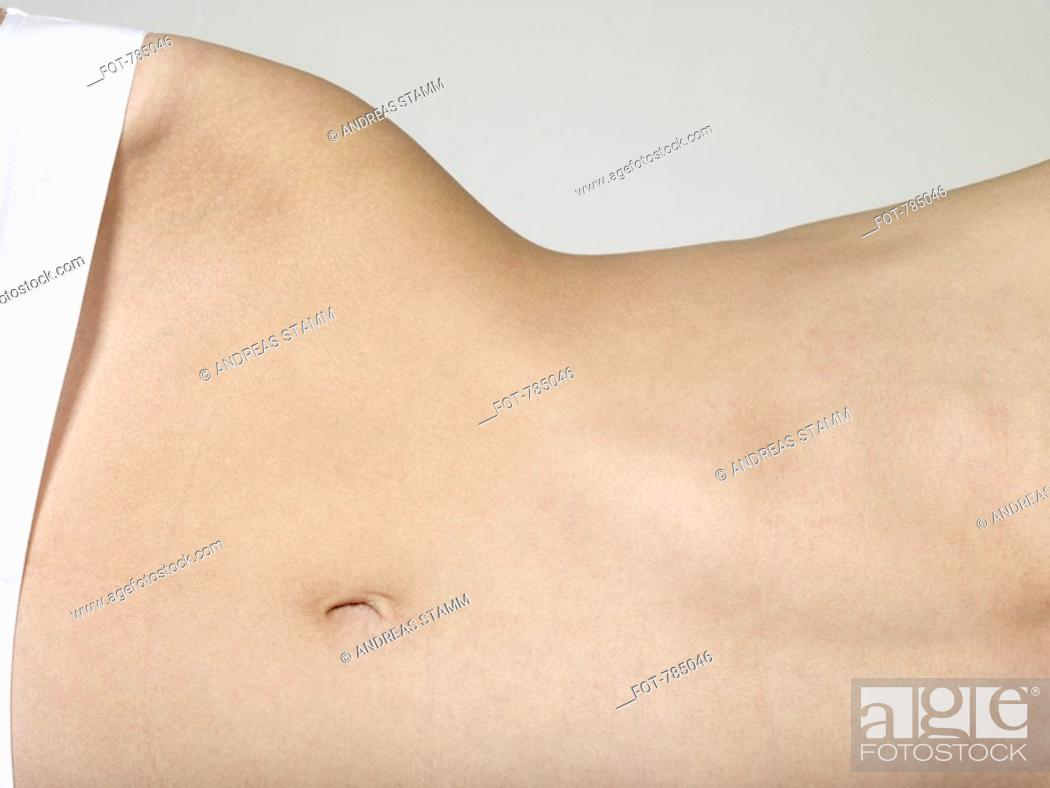 Stock Photo: Midsection of a woman lying on her side.