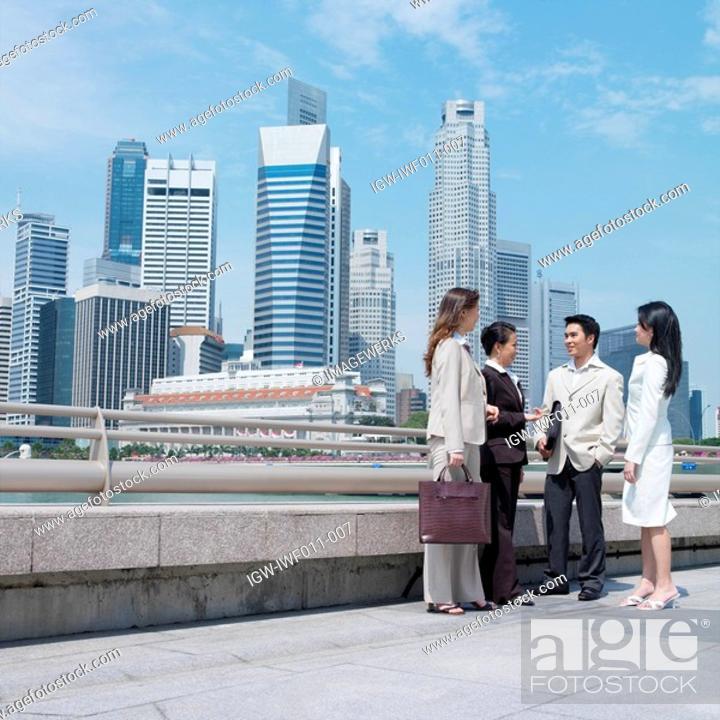 Stock Photo: Businessman talking to three businesswomen.