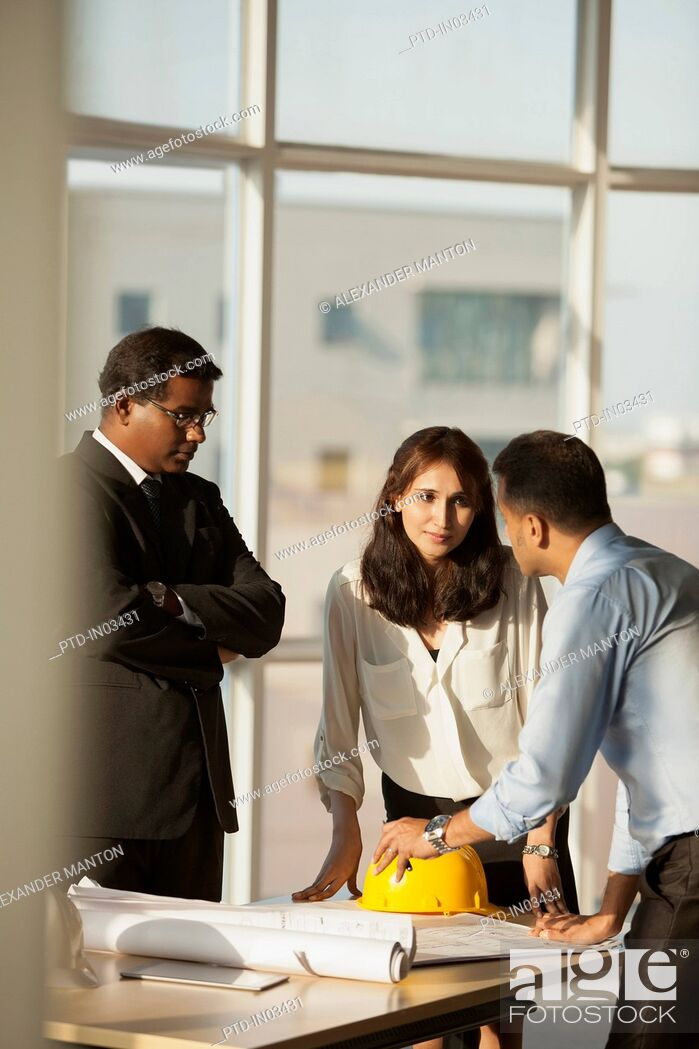 Stock Photo: Singapore, Architect discussing building plans with customers.