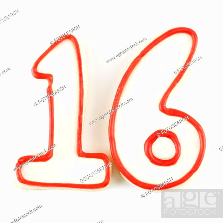 Stock Photo: Sugar cookies in the shape of the number sixteen outlined in red icing.