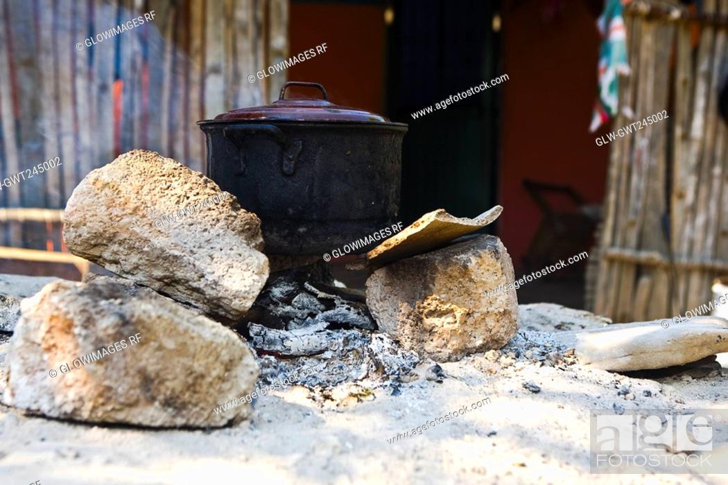Stock Photo: Saucepan on a stove.
