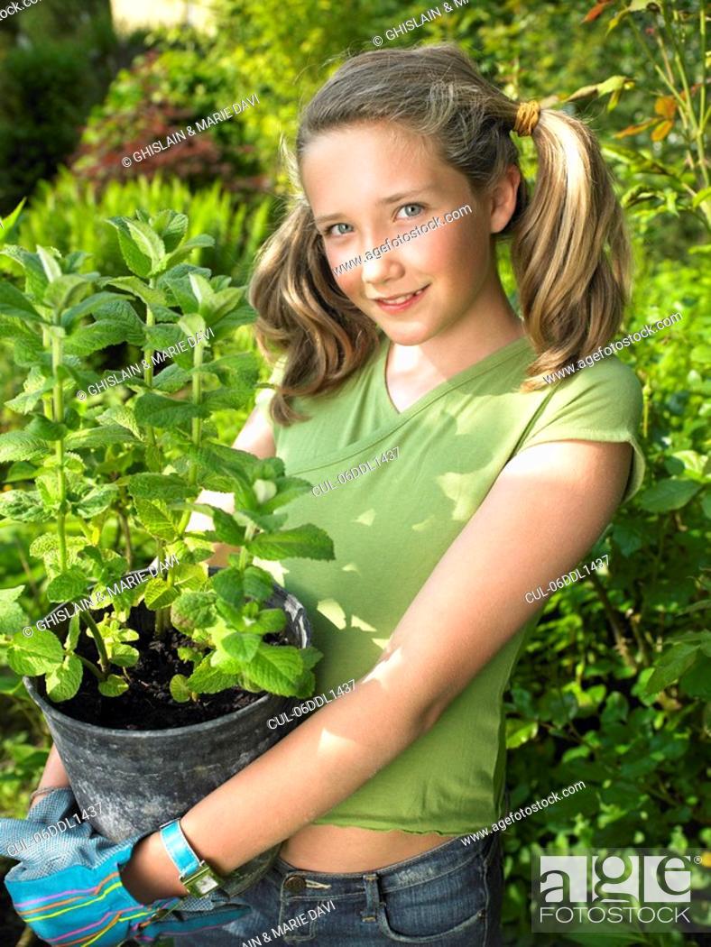 Stock Photo: Girl working in the garden.