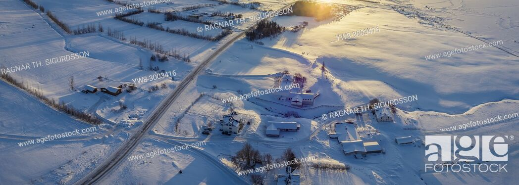 Stock Photo: Panoramic top view of snow covered farm in Akureyri, Northern Iceland. This image is shot using a drone.