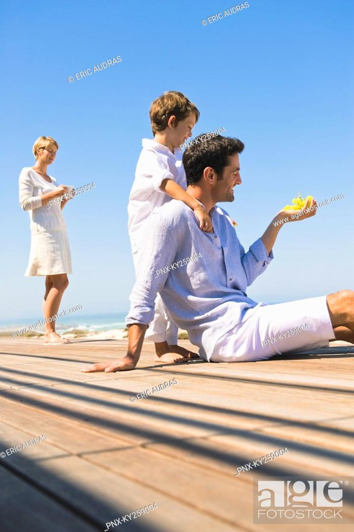 Stock Photo: Family on vacations on the beach.