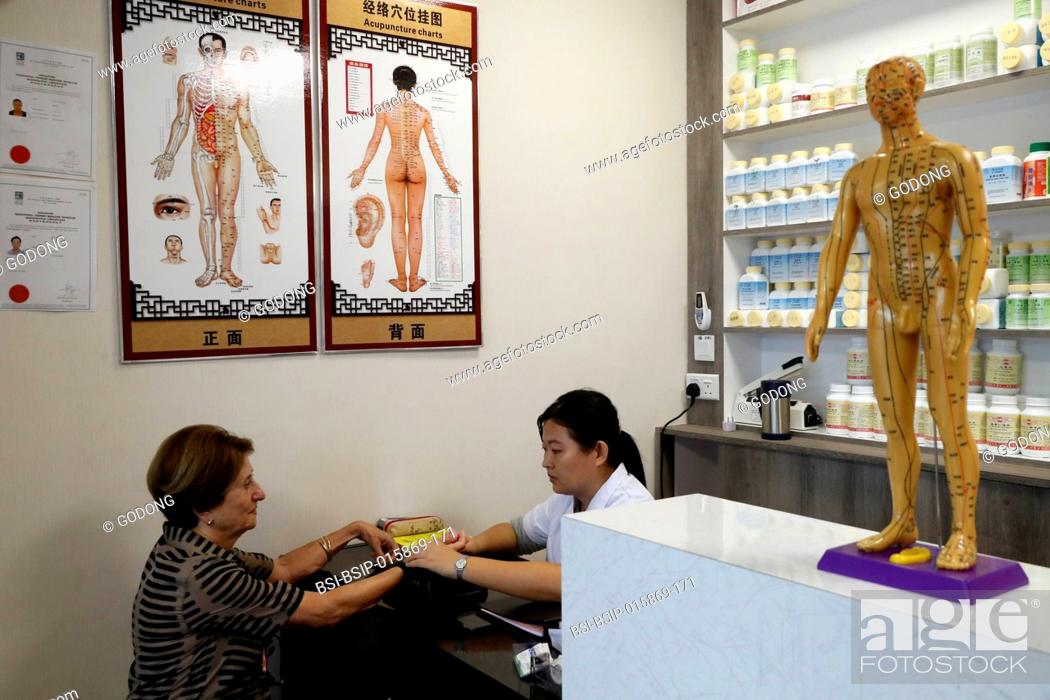 Stock Photo: Traditional Chinese Pharmacy. Chinese medicine practitioner. Singapore.