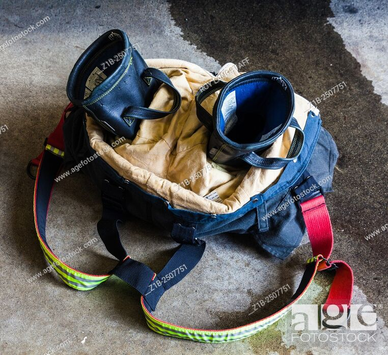 Stock Photo: Detail of a fireman's pants and boots in readiness for an emergency call from a Vancouver Fire Hall.