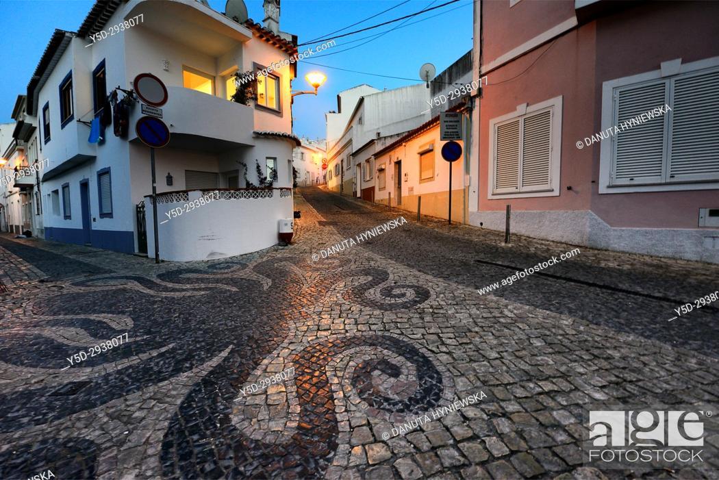 Stock Photo: Europe, Portugal, Western Algarve, Faro district , Lagos, street scene at night, old town, Calçada portuguesa in foreground.