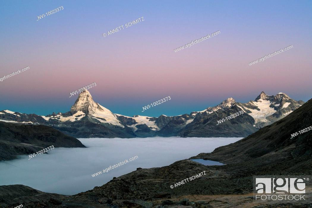 Stock Photo: Matterhorn with clouds at dawn, Switzerland.