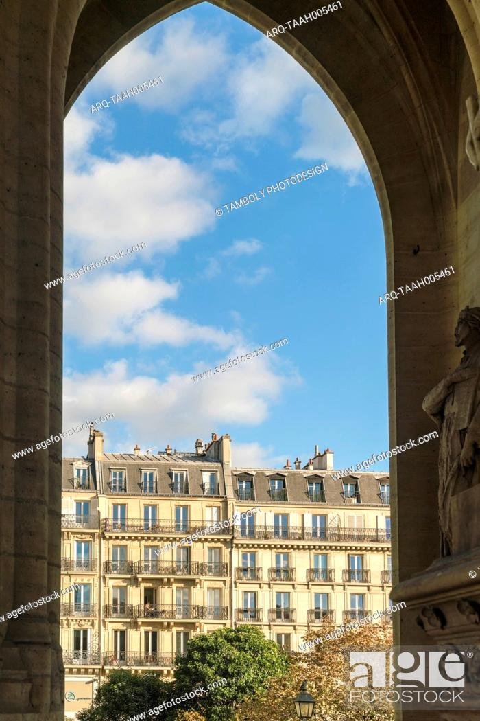 Stock Photo: Exterior of historic buildings under blue sky with clouds at square of St Jacques, Paris, France.