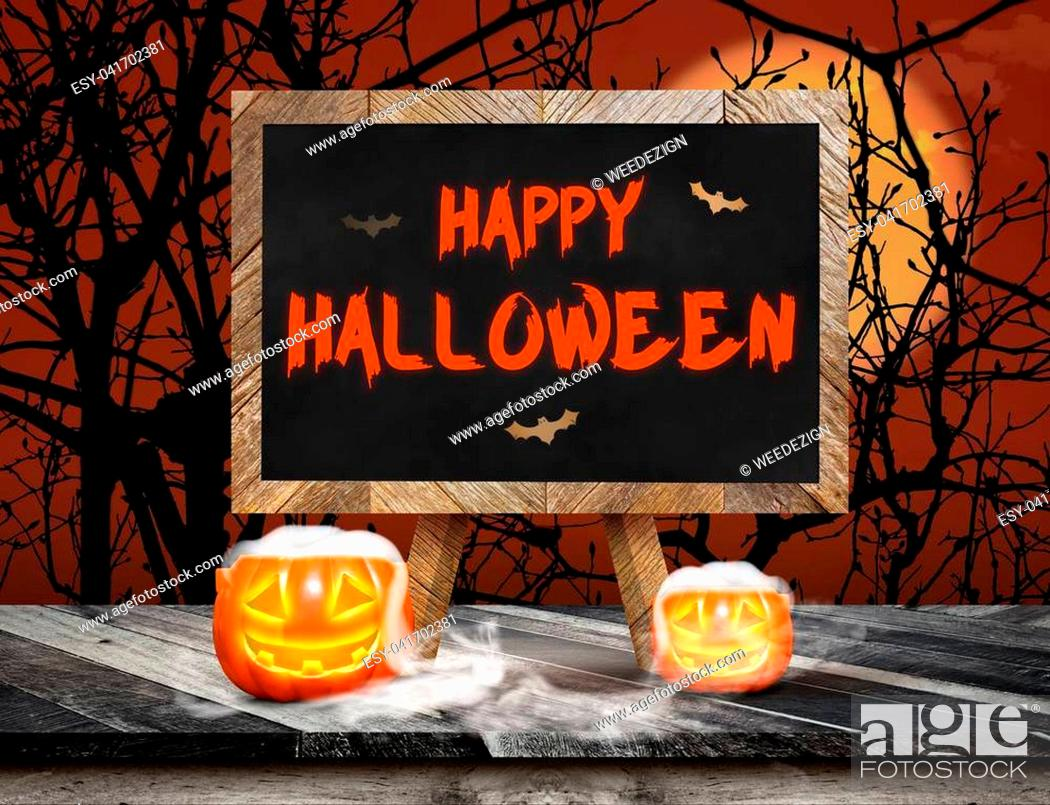 Imagen: Happy Halloween on blackboard with easel on grunge plank wooden and pumpkin with smoke on table top at spooky dead tree and full moon, Halloween invitation card.