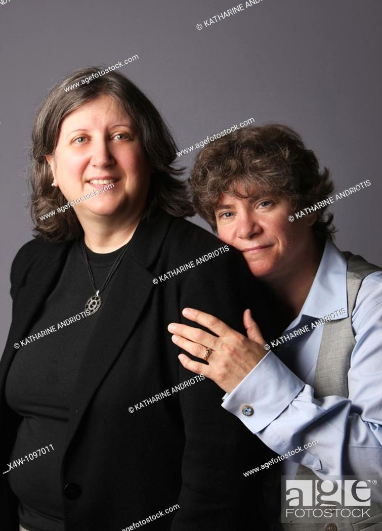 Imagen: Married lesbian couple portrait looking at camera.