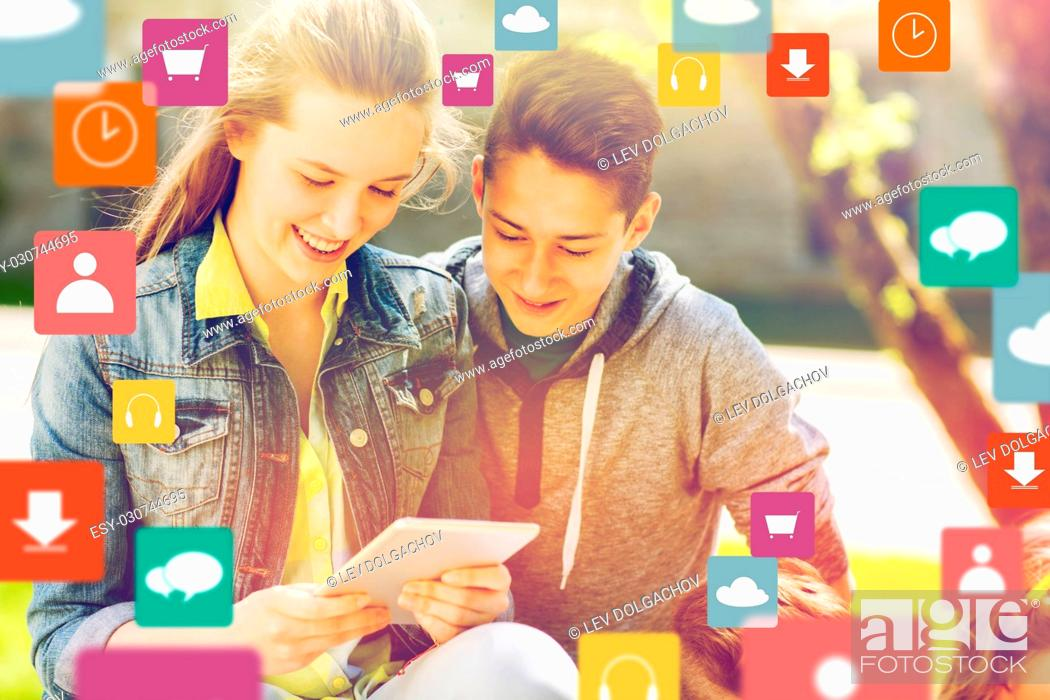 Stock Photo: technology and people concept - happy teenage friends or students with tablet pc computer and menu icons outdoors.