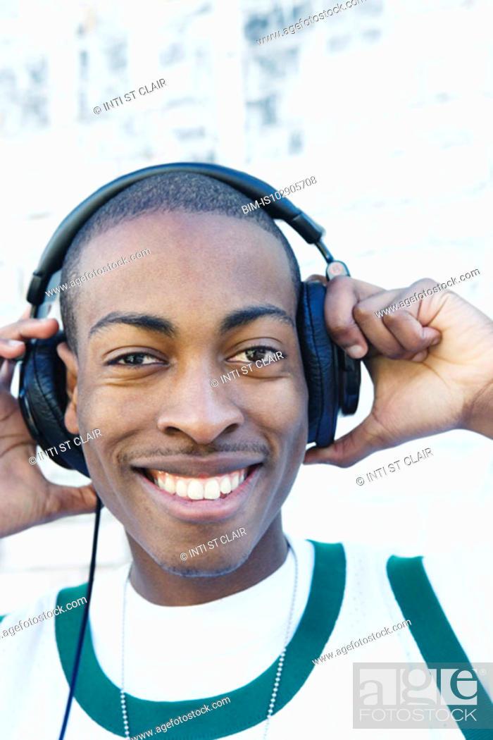 Stock Photo: Teenage boy wearing headphones.