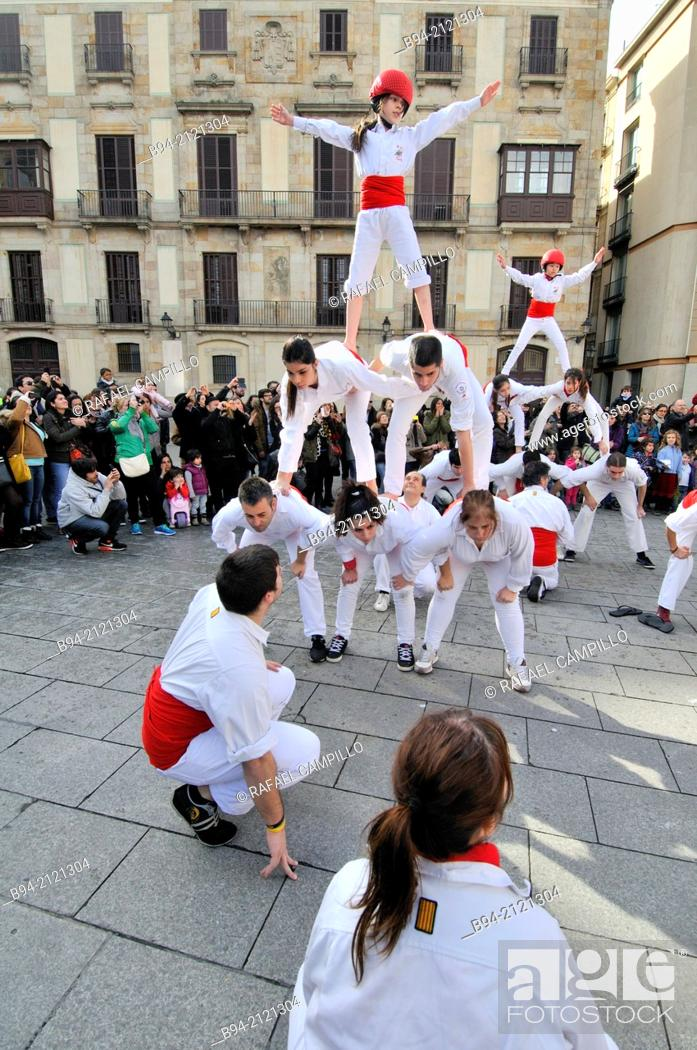 Stock Photo: Castell, human tower. Falcons group. Celebration of saint Eulalia martyr, February 12. 290-303 AD. Canonized 633 AD. Copatron of Barcelona. Plaça Nova.