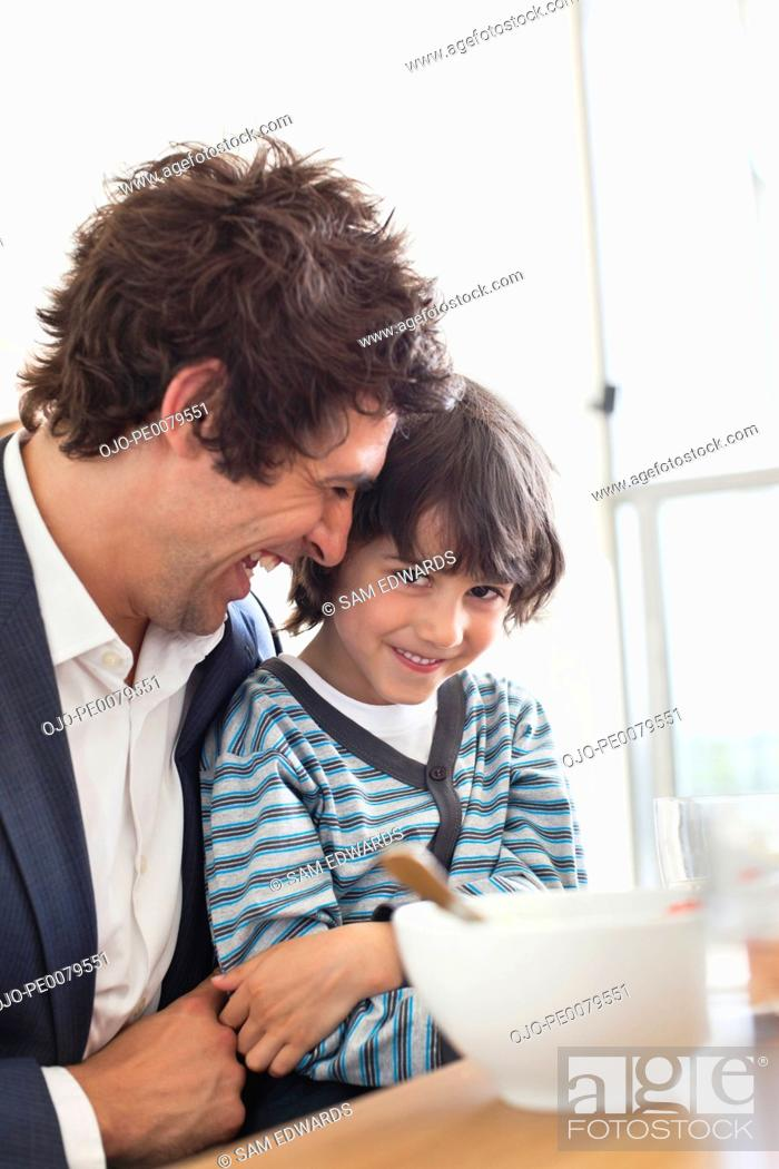 Stock Photo: Father and son eating breakfast together.