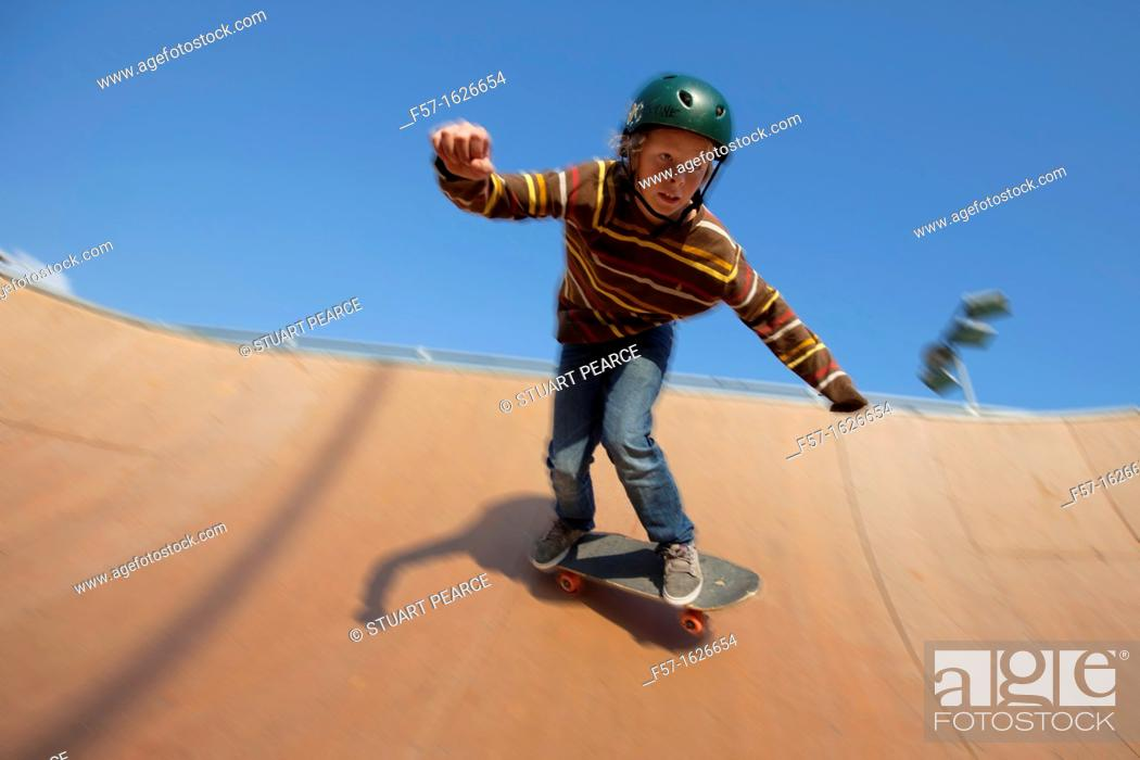 Stock Photo: Young teenager skateboarding in a bowl.