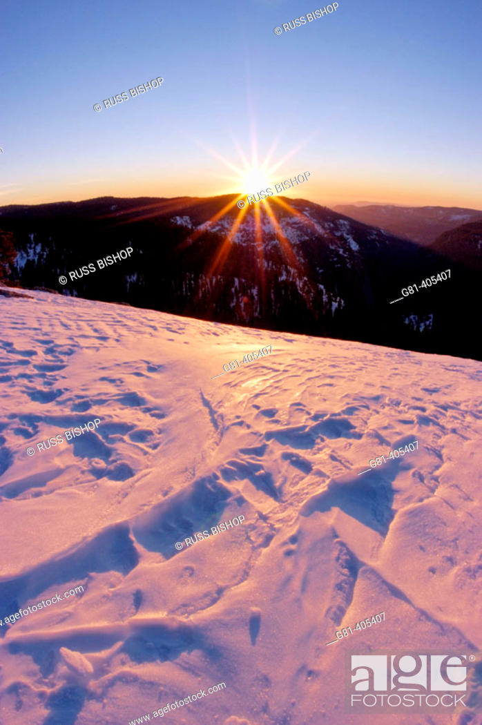 Stock Photo: Sunset and windblown snow from the summit of Sentinel Dome, Yosemite National Park, California.