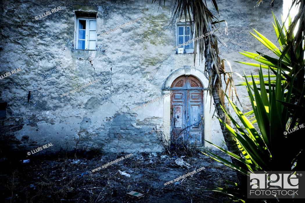 Stock Photo: Facade of an abandoned village house at dusk. Santo- Pietro-de Tenda, Corsica, France, Europe.