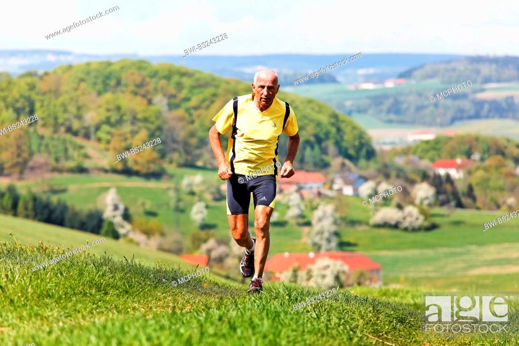 Stock Photo: Elderly jogger training for his fitness jogging.