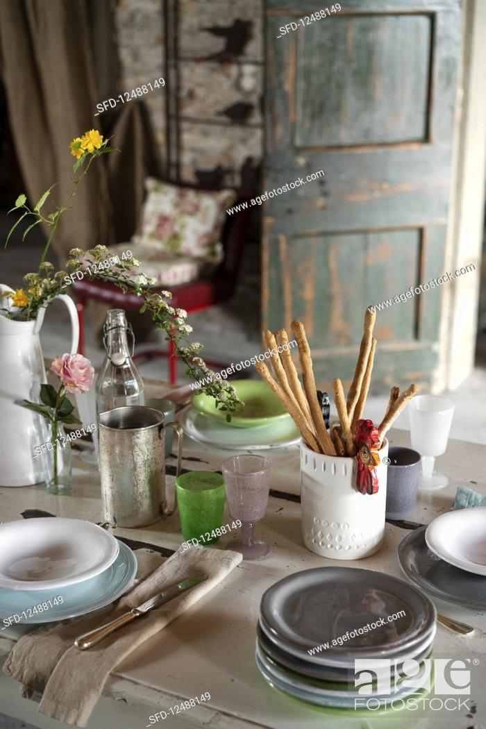 Stock Photo: A table laid with grissini (Italy).