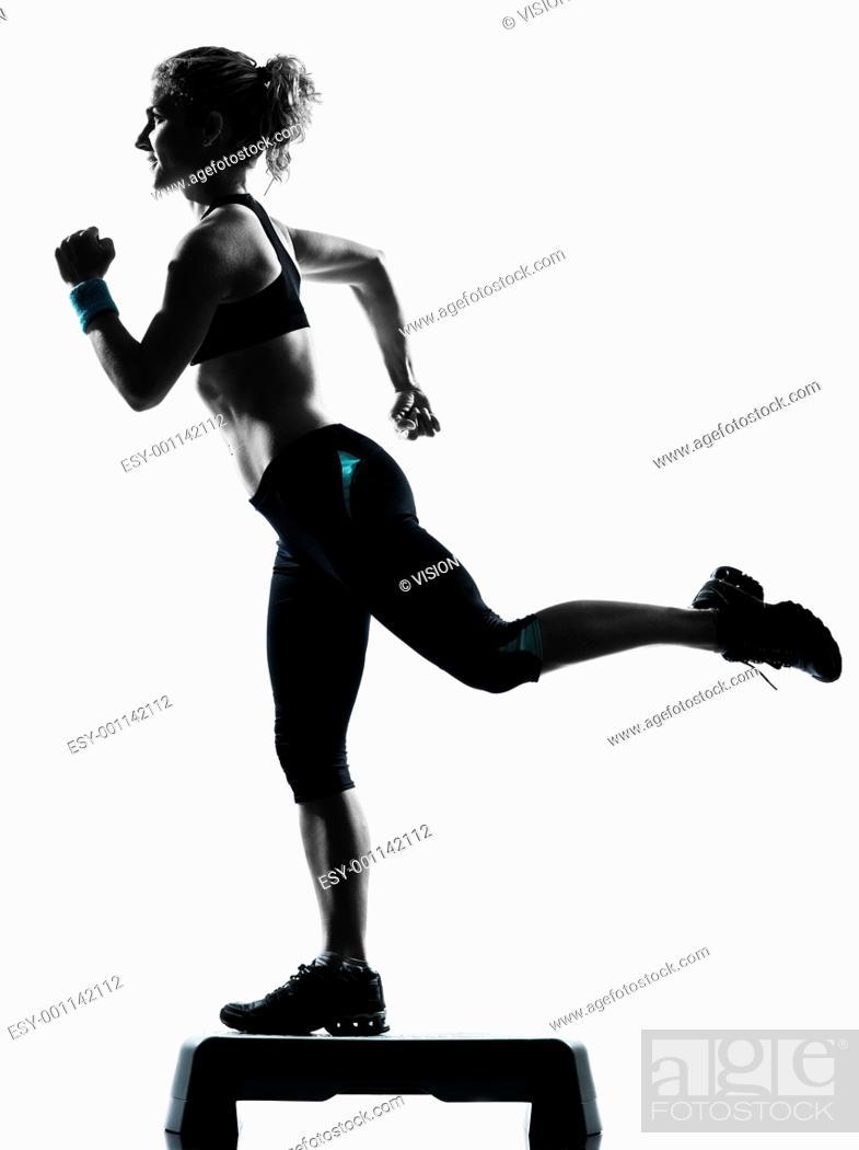 Stock Photo: one woman exercising workout fitness aerobic exercise posture on studio isolated white background.