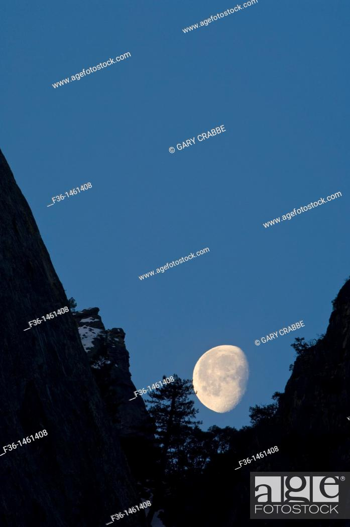 Stock Photo: Waning gibbous moon setting behind mountain cliff, Yosemite National Park, California.