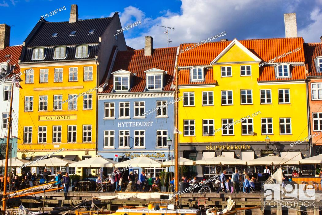 Stock Photo: Alfresco canalside tables and chairs and brightly painted townhouses, Nyhavn, Copenhagen, Denmark, Scandinavia. 17th century waterfront canal and entertainment.