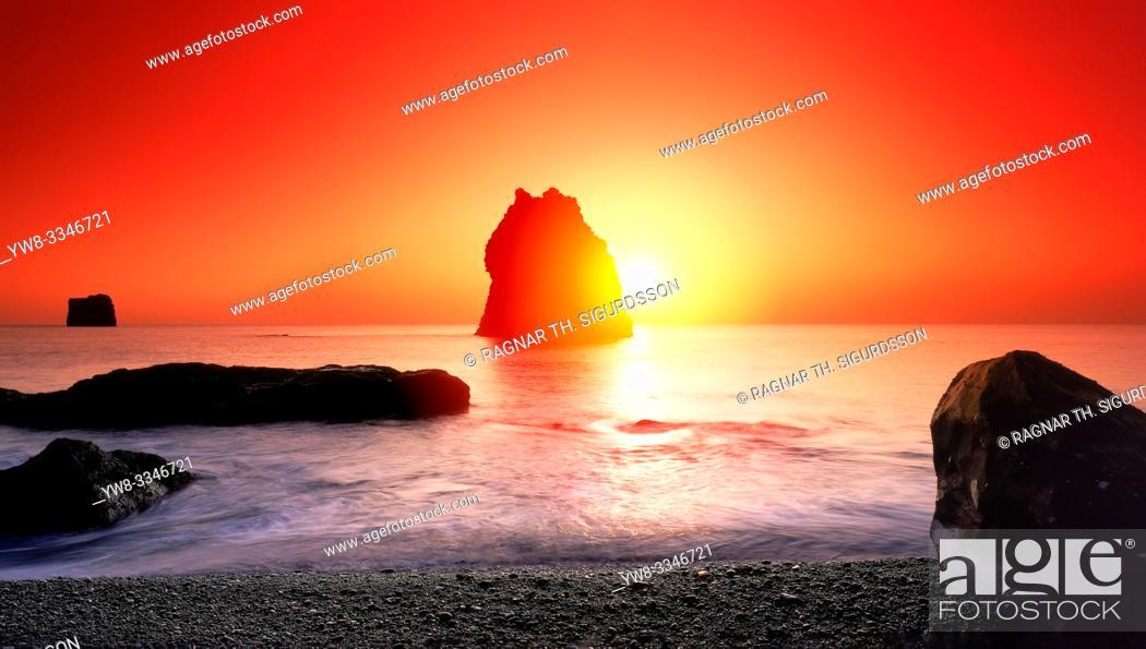 Stock Photo: Sunset over rock formations, Reynisfjara beach, South Coast, Iceland.