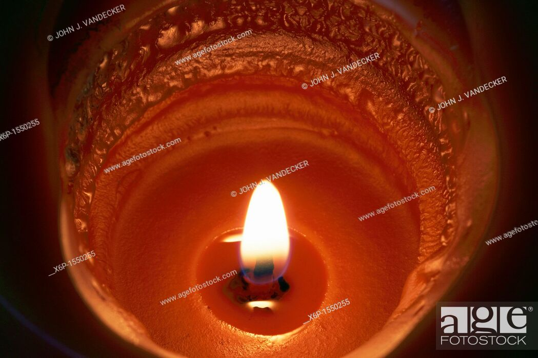 Stock Photo: A Pumpkin Spice scented candle burning.