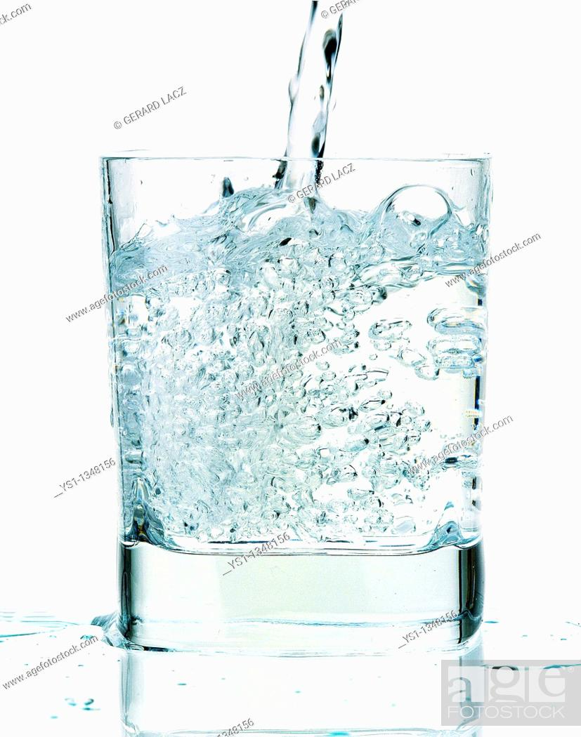 Stock Photo: GLASS OF WATER AGAINST WHITE BACKGROUND.