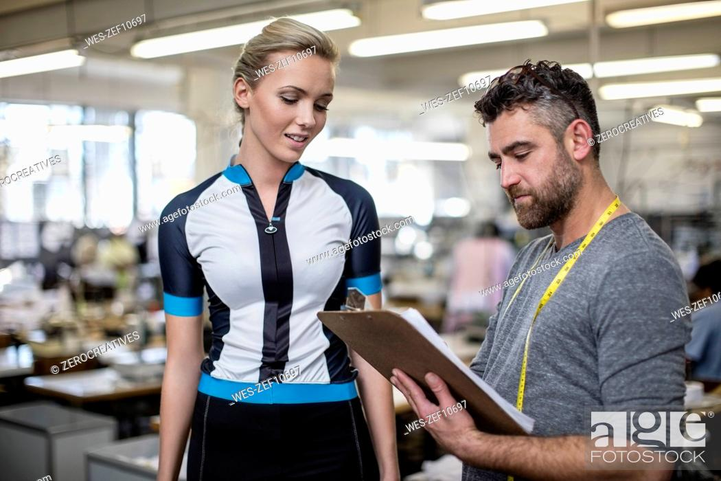 Stock Photo: Tailor with model fitting sportswear.