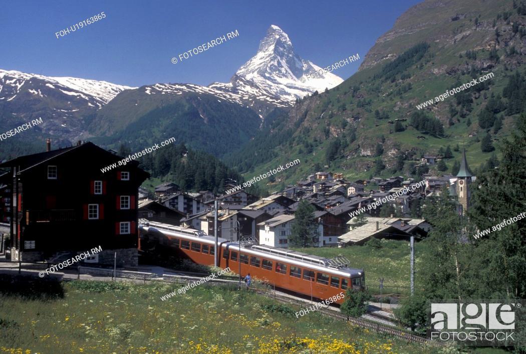 Stock Photo: train, Switzerland, Zermatt, Valais, Matterhorn, Alps, Gornergrat Bahn (train) travels through the scenic mountain resort village of Zermatt with a view of the.